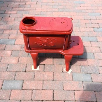 cast iron box stove with number 16 or 18 on feeder door