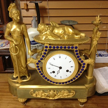 heavy Golden Clock Don't know how old it is or how much it is worth..