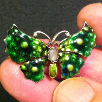Unknown maker for this cute butterfly.