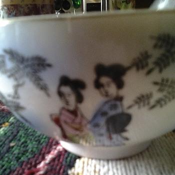 asian cups with lady's face in bottom