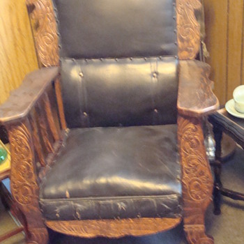 antique rocker with lion engravings and leather upholstry. - Furniture