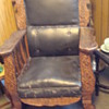 antique rocker with lion engravings and leather upholstry.