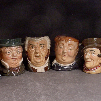 Complete set of Doulton odd size jugs.