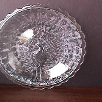 Information needed on small crystal Peacock plates with an M.  - Glassware