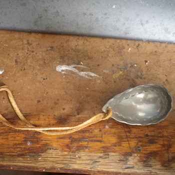 "Decorated Metal spoon with leather strap, non English writing ""Tenn Handars LGS"" nicely decorated inside bowl."