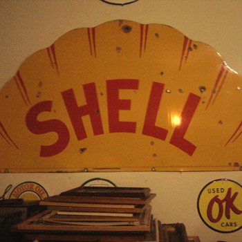 The Shell sign had to be bolted.  Bought for only $90 years ago at an auction but moving it waqs the high price of buying it., - Signs