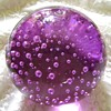 Purple glass bubble paperweight