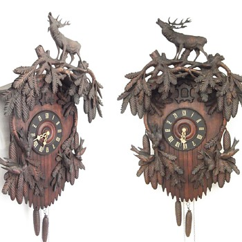 4 large magnificent antique carved cuckoo clocks,  and a trumpeter clock.  Ornate carving.  STUNNING!
