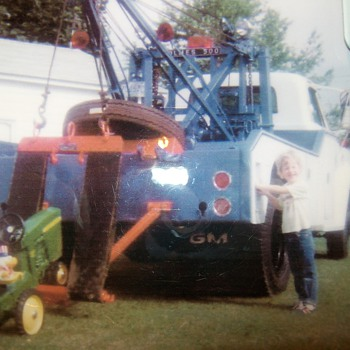 My favorite wrecker ,my pedal tractor and some little punk!