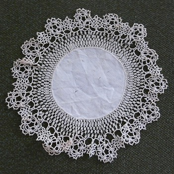 FOUR DOILIES