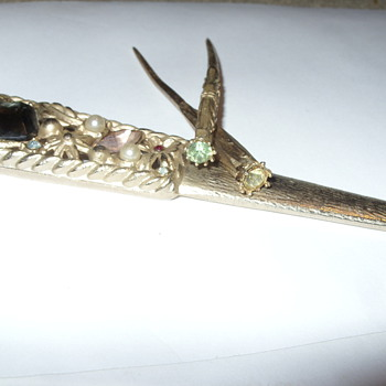 Letter opener with hair/hat sticks/pins
