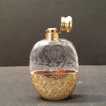 A beautiful ladies flask with gold  - Bottles