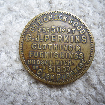 G.J. Perkins Clothing & Furnishings Hudson Mich. Good Luck Swastika Discount Token