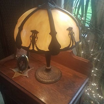 Who made this slag lamp?   Very heavy!   Has Cross with #8 on the underside of it