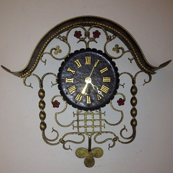 A metal clock - Clocks