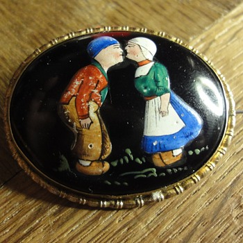 An enamal brooch with couple in traditional costumes - Costume Jewelry