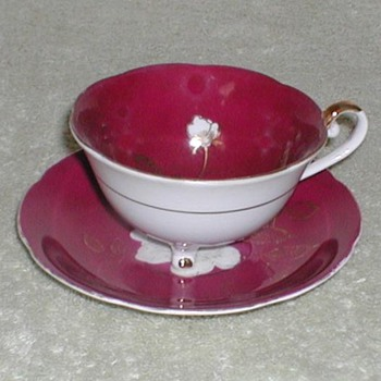Porcelain cup & saucer wine color