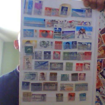 english and us stamps two books full all diffrent sorts all over world, then theres the picture mirror  and theres the row i th - Coca-Cola