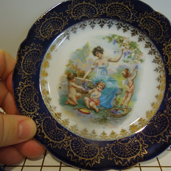 "two 6"" dishs with 1) angel scene and 2) Ladies on bridge scene"