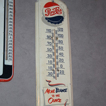 pepsi sign and thermometers