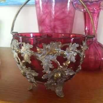 Red glass bowl and basket of gold and silver coloured metal with cabriole feet