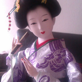 Geisha doll with porcelain face