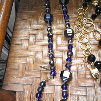 Unusual iridescent blue/gold plastic beads - Costume Jewelry
