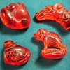 3 Netsuke and a dragon head stamp -any idea what they could be made of?