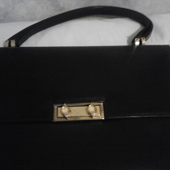 Black hand Bag with a brief case appearance.  - Bags