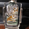 Chinese reverse painting of tigers inside glass snuff bottle