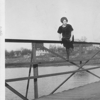 Sitting on a bridge rail ! My grandma 1917-1920 . Pretty brave :-) - Photographs