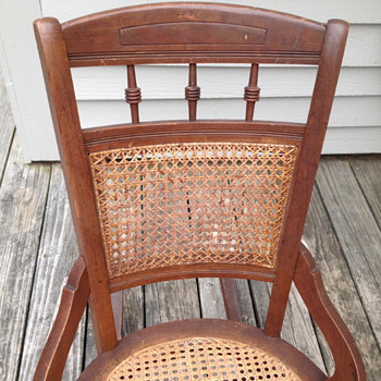 Rocking chair with cane back and seat