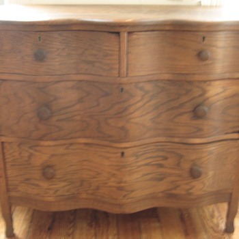 MY fellow collectors!!  Please help me identify this dresser!!  I love it but am not sure of its history.
