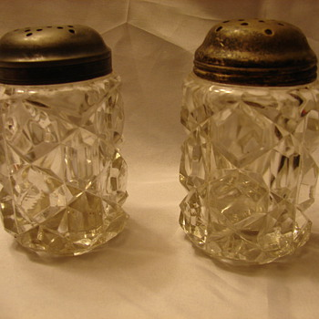 2 Very Heavy Glass Shakers.