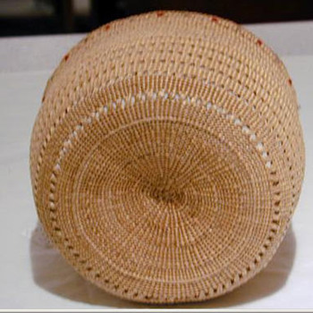 This is an Attu basket. It is a finely woven(by my people, Aleuts) its even water-proof. My tribes history goes back 9000 yrs - Native American
