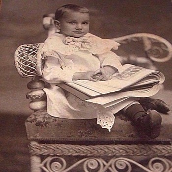 Sweet Photo Of a BOY, IN A GREAT CHAIR,WITH A PICTURE BOOK, SLIPPERS ON FEET?
