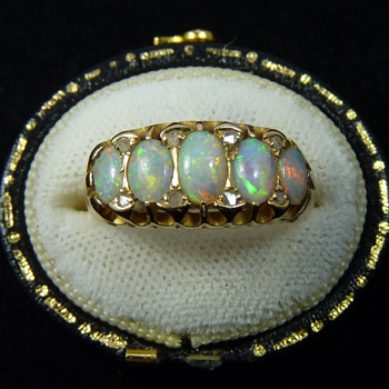 "A White Cliffs Opal and Diamond ""London Bridge"" Ring in 18ct Gold, Birmingham 1907"