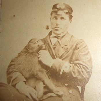 Early image of man with a pet Monkey