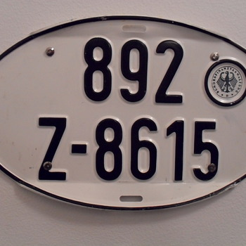 Oval German auto licence plate.