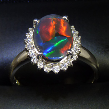 1.9ct Black Opal - rescued from an old stick pin, and set in a ring with a halo of diamonds