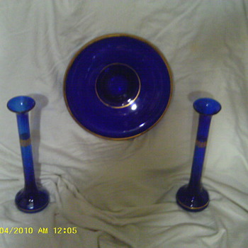 all i know its blue glass cant find any info at all on these items i beleive they r a set - Glassware