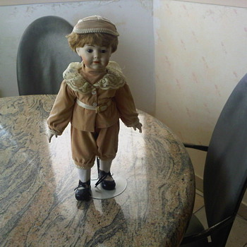 Beautiful Porcelain Doll Mounted on Stand, Completely Clothed - Dolls