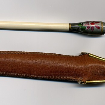 Ivory? Cigarette holder.