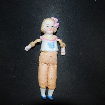 bisque, oil cloth doll