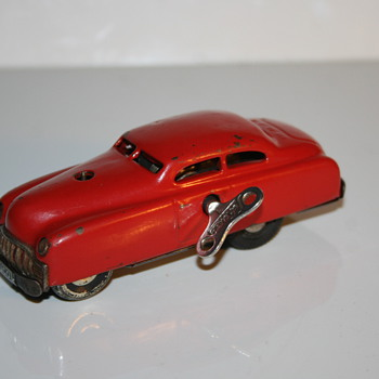 schuco tin toy car limo red version