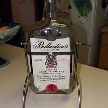 Ballantine&#039;s Finest Scotch Whisky with holder.  133 1/2 ounces. Establised 1827