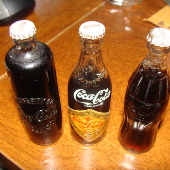 3 in filled glass coke bottles with metal caps - Coca-Cola