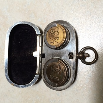 Vintage brass coin holder and old perfume bottle