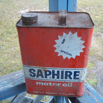 old oil and antifreeze cans
