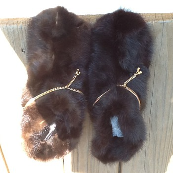 Vtg Oomphies appear to be fur with gold chain